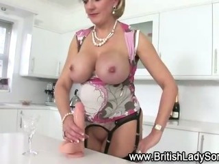 Mature fake blond british slut rides a Dildo on a counter top